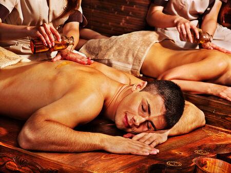 Couple  having oil Ayurveda spa treatment. photo