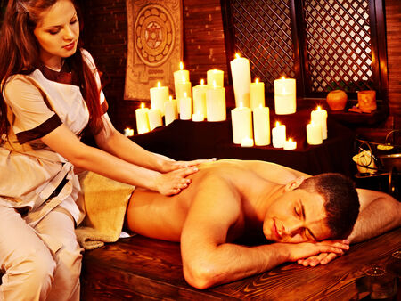 body oil: Young man having oil Ayurveda spa treatment. Stock Photo