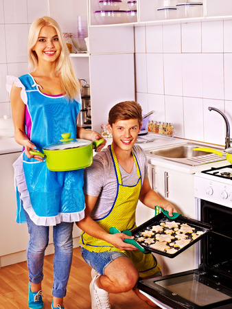 Happy famiy baking cookies in oven. photo