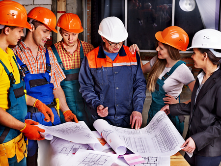 Business group people in builder helmet indoor  photo