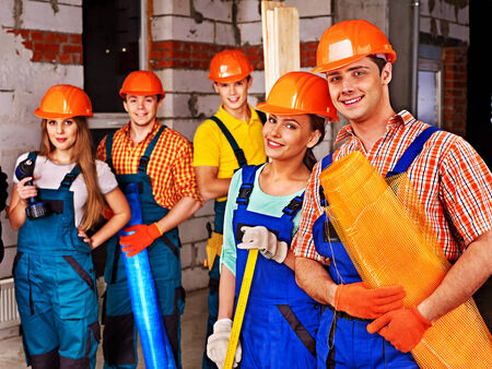 millwright: Happy group people in builder uniform