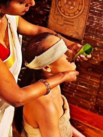 window treatments: Woman having nose ayurveda spa treatment.