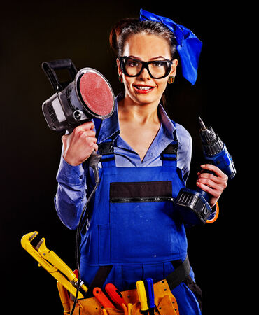Happy woman builder with construction tools. photo