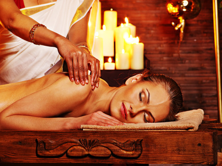 Young woman having oil Ayurveda spa treatment. Stock Photo