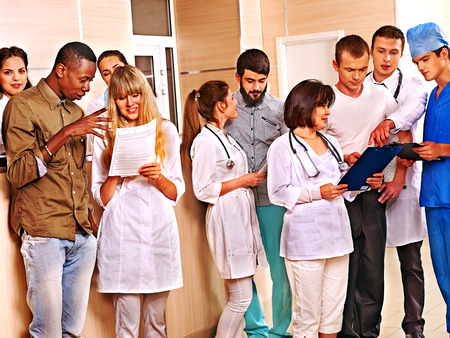Large group doctors standing at reception in hospital. Stock Photo - 28451682