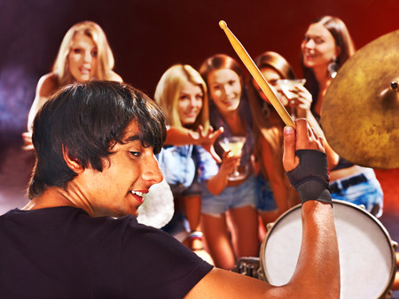 Musical group playing in night club. Male and female. Stock Photo