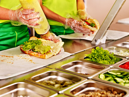 veggie tray: Tray with cooked food on showcase at cafeteria. Stock Photo