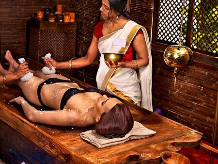 window treatments: Young woman having feet Ayurveda spa massage.