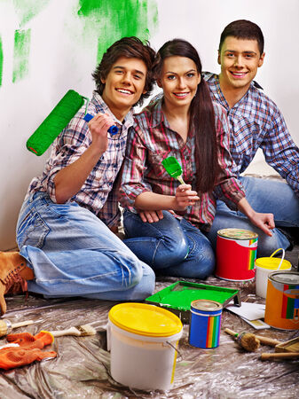Happy family laying parquet at home. Stock Photo