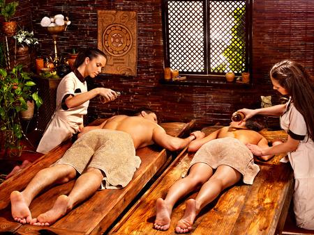 window treatments: Couple  having oil Ayurveda spa treatment  Stock Photo