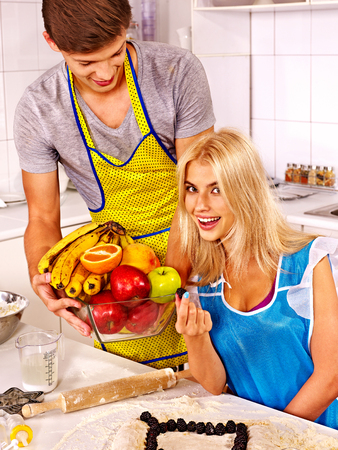 Young happy family cooking at kitchen  photo