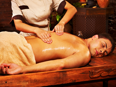 panchakarma: Man  having oil Ayurveda spa treatment.