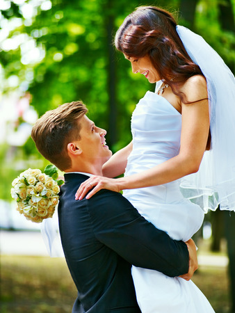 Bride and groom with flower summer  outdoor. photo