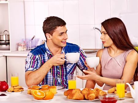 Happy couple breakfast at kitchen. photo