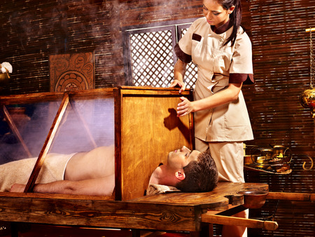 panchakarma: Woman having Ayurvedic sauna treatment.