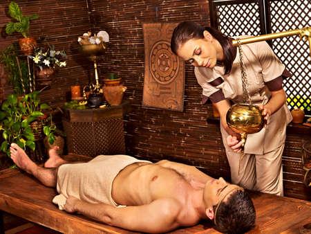 panchakarma: Young woman having Ayurveda spa treatment.