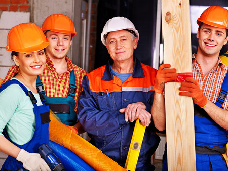 laborers: Happy group people in builder uniform.