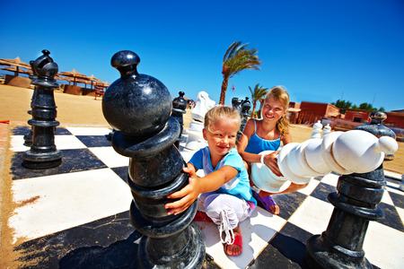 Children playing big chess outdoor  photo