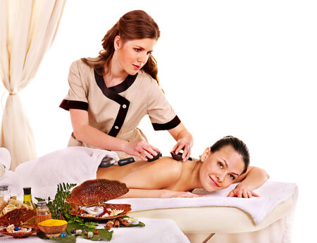 lastone: Young woman getting spa lastone therapy outdoor  Isolated  Stock Photo
