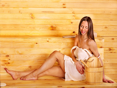 overheating: Young woman in sauna  Overheating danger  Stock Photo