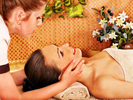 parlour: Woman getting head massage in tropical beauty spa.