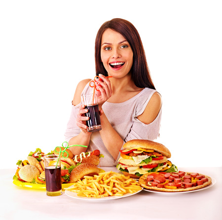 Woman eating fast food. Isolated. Stock Photo - 29378566
