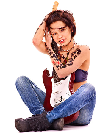Young cheerful woman with tattoo playing guitar. Stock Photo - 29378611