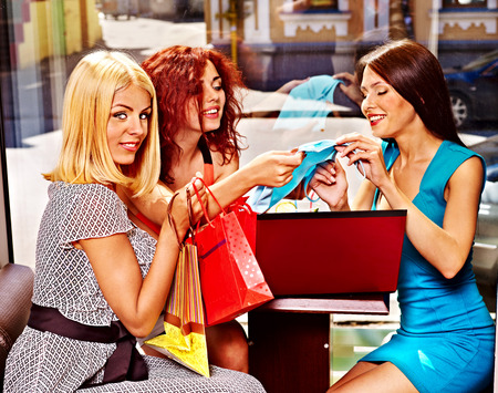 Gossip women with laptop in a cafe. Stock Photo - 29378616