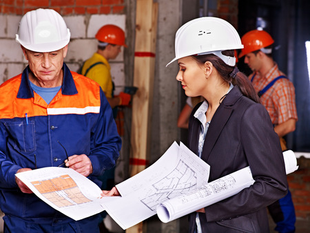 Business woman in builder helmet indoor. Stock Photo - 29368681