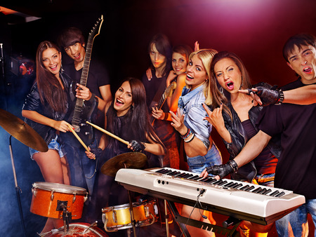 play popular: Musical group male and female  performance in night club.