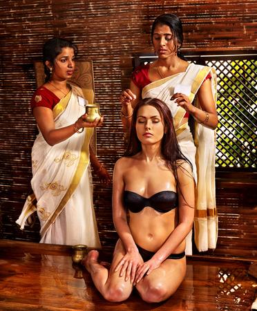 panchakarma: Young woman having head ayurveda spa treatment.