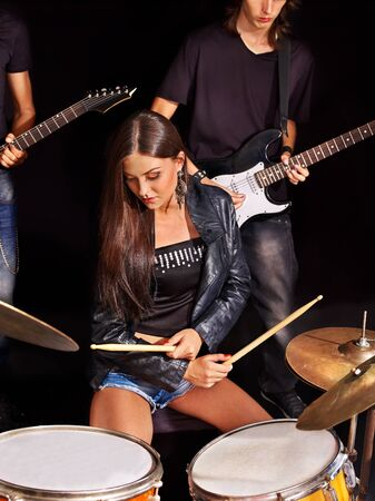 Young woman playing  guitar in night club. photo