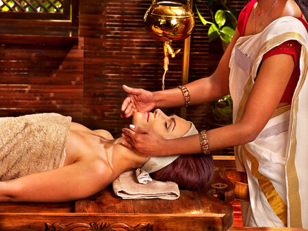 Woman having facial  ayurveda spa treatment. Stock Photo - 29945578