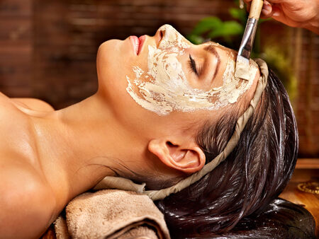 Woman having facial mask at ayurveda spa. Stock Photo - 29945601