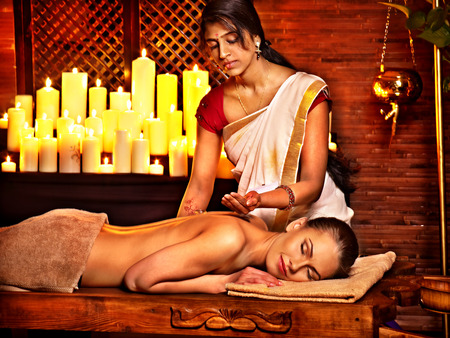 Young woman having oil Ayurveda spa treatment. Stock Photo - 29945584