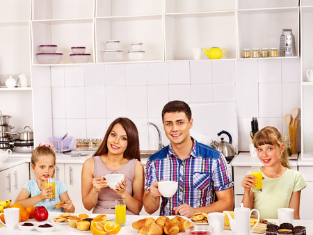 Parents prepare  breakfast for child. Happy family. Stock Photo - 29945608