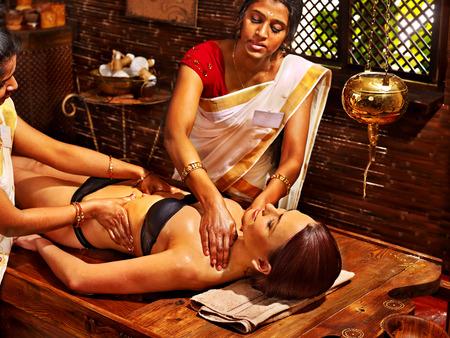 Young woman having stomach Ayurveda spa treatment. Archivio Fotografico