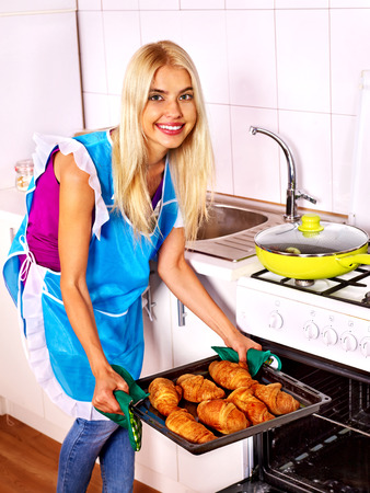 bap: Young woman bake cookies. Kitchen.