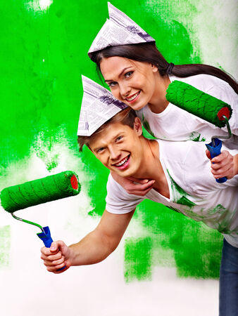 Happy family paint wall at home. photo