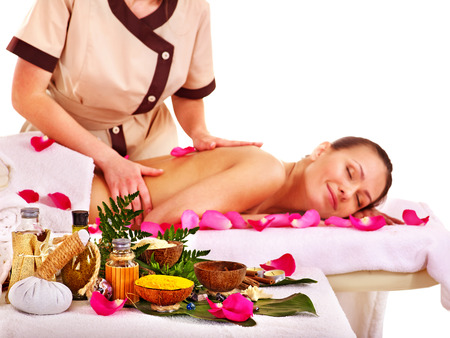 Young woman getting massage in spa . Isolated. photo