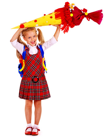 first day: Child with backpack holding  school cone. Isolated. Stock Photo