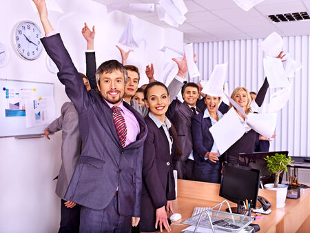 copier: Happy group business people with hand up in office.
