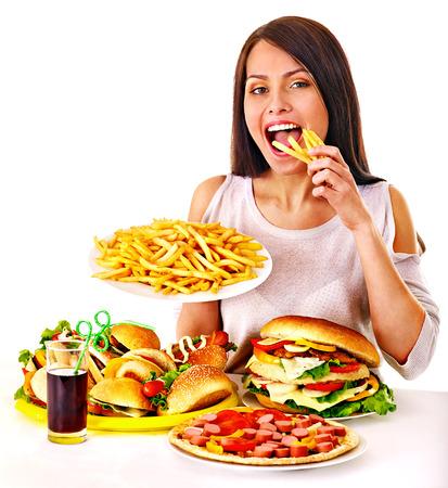 Vrouw die fastfood eet. Geïsoleerd. Stockfoto - 31449788