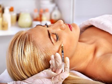 botox: Beauty woman giving botox injections. Stock Photo