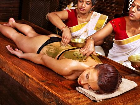 window treatments: Young woman having body Ayurveda spa massage.