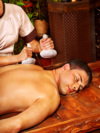 window treatments: Couple  having oil Ayurveda spa treatment. Stock Photo