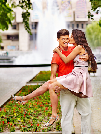 Happy couple at park . Summer outdoor. photo
