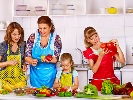 Happy family with child cooking at kitchen. Grandfather and grandmother. kitchen. photo