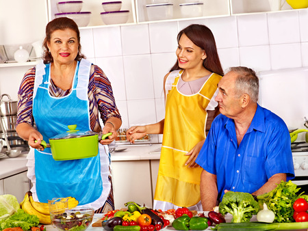 Big family cooking at kitchen. Grandfather and grandmother. photo