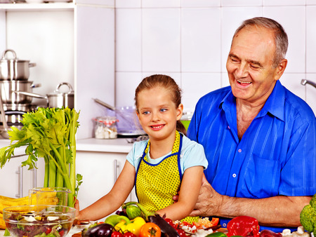 Big family cooking at kitchen. Grandfather and children. photo